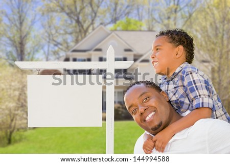 Happy African American Father and Mixed Race Son In Front of Blank Real Estate Sign and New House. - stock photo