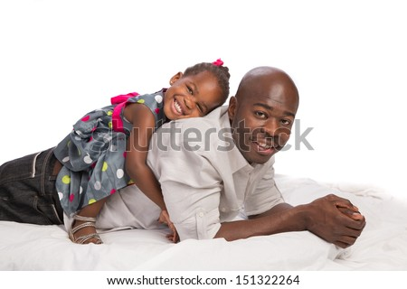 Happy African American Father with Baby Girl on Back white background - stock photo