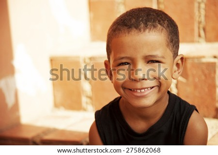 Happy african american little boy smiling - stock photo