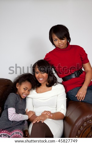 Happy african american mother and her daughters