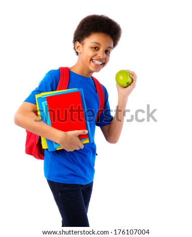 Happy African American school boy, teenager with colorful books, school bag and apple. Education and school concept. Isolated, over white background, with copy space. - stock photo
