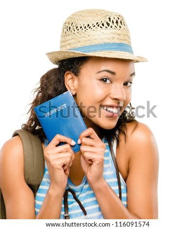 Happy African American woman tourist holding passport - stock photo