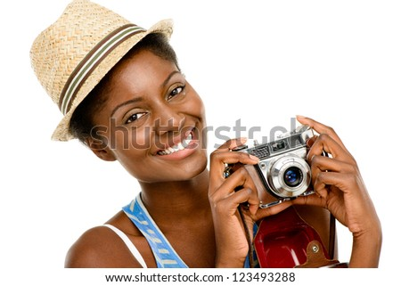 happy African American woman tourist holding vintage camera isolated on white background - stock photo