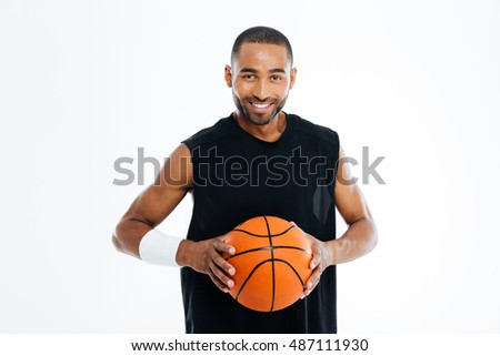 Happy african basketball player standing with ball isolated on a white background