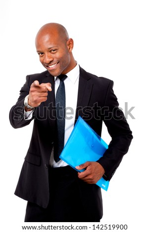 Happy African business man holding a folder and pointing at camera shot on an isolated background - stock photo