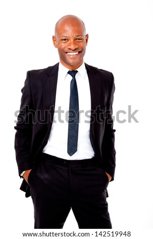 Happy African business man with his hands in his pockets shot on an isolated background - stock photo
