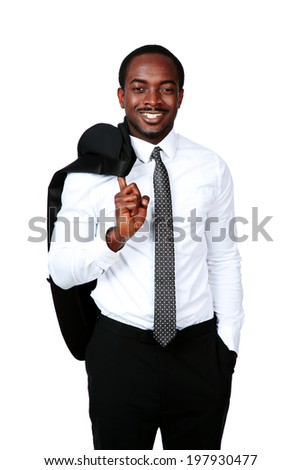 Happy african businessman stands with his jacket over his shoulder
