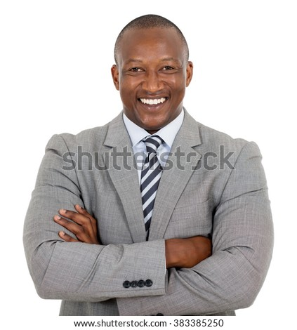 happy african businessman with arms crossed  - stock photo