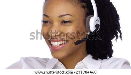 Happy African businesswoman talking with headset - stock photo