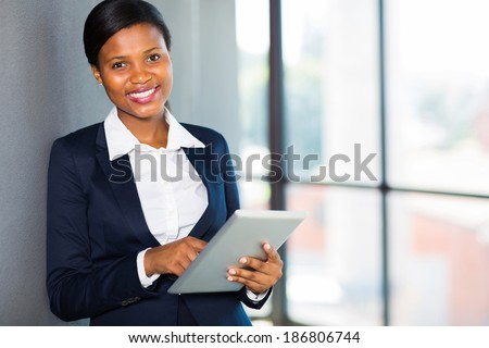 happy african businesswoman using tablet computer in office - stock photo