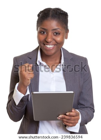 Happy african businesswoman with tablet computer - stock photo