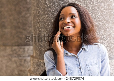 happy african college girl talking on mobile phone  - stock photo