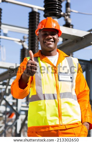 happy african electrical engineer giving thumb up - stock photo