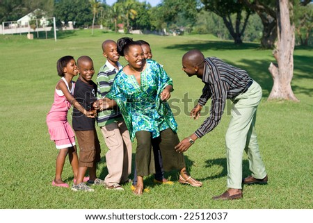 happy african family playing a game together - stock photo