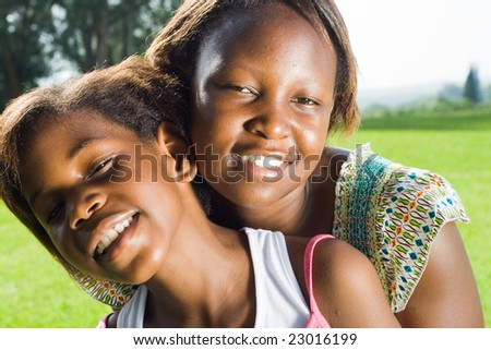 happy african sisters together