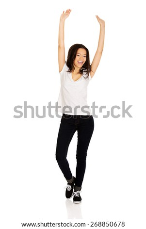 Happy african teen woman with hands up. - stock photo