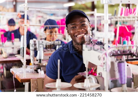 happy african textile factory worker portrait - stock photo