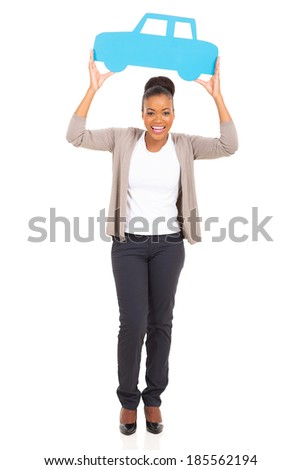 happy african woman holding paper car and looking at camera - stock photo