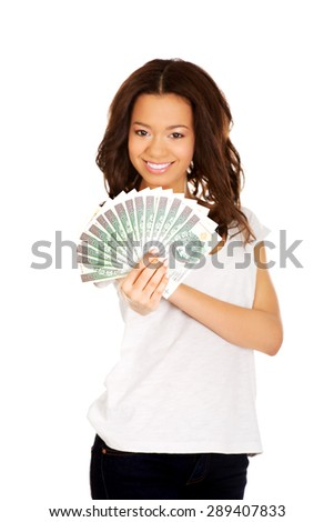 Happy african woman holding polish money.