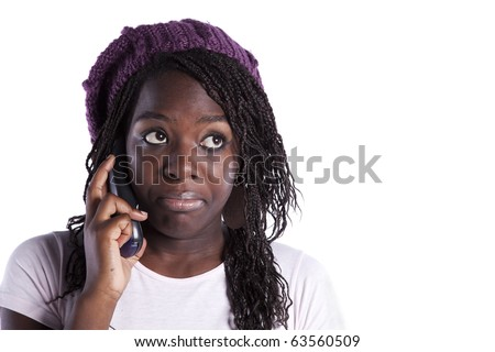 happy african woman speaking at the telephone and looking to the copy space (isolated on white) - stock photo