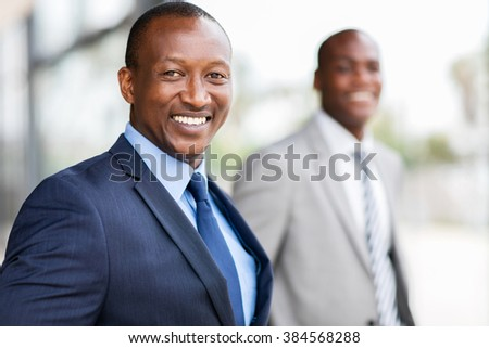 happy afro american businessman looking at the camera