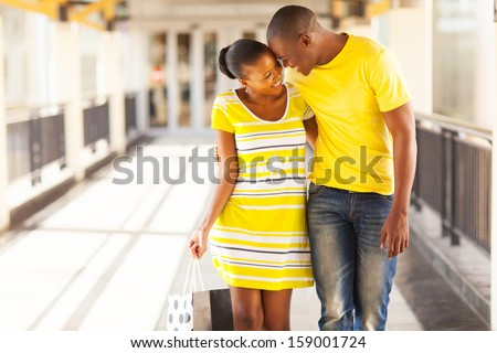 happy afro american couple flirting in shopping mall - stock photo