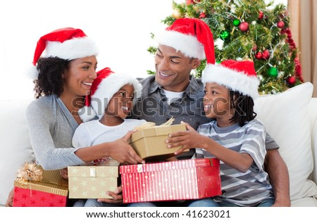 Happy Afro-American family celebrating Christmas at home - stock photo