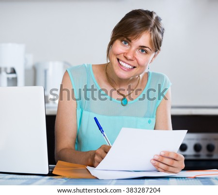 Happy american adult girl applying for bank loan at home - stock photo