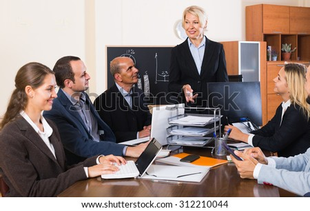 happy american  colleagues discussing price development at office - stock photo