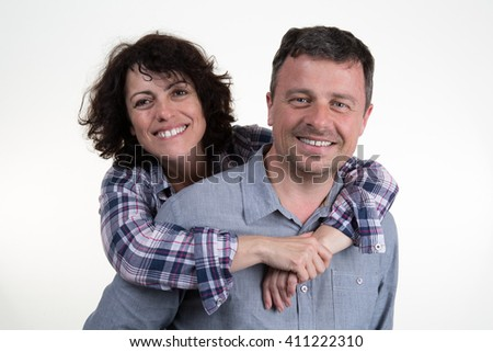 Happy and a smiling couple, isolated on white - stock photo