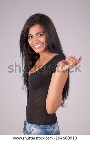 Happy and beautiful latin woman, looking to camera,  studio shot - stock photo