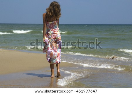 happy and beautiful young woman on sea coast (stylization birth goddess of love Aphrodite)