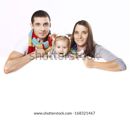 Happy and cheerful family pose on a blank on the banner