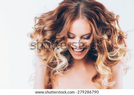Happy and cheerful young lady. Portrait of attractive caucasian smiling woman - stock photo