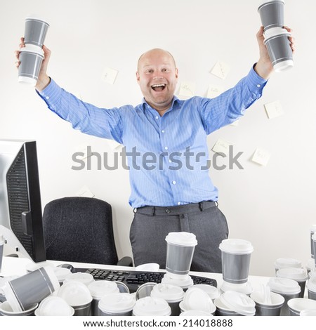 Happy and coffee addicted businessman at office - stock photo