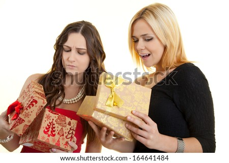 happy and disappointed girls with christmas gift