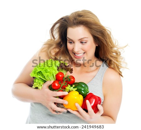 Happy and excited real woman with fresh vegetables.