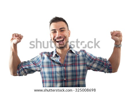Happy and excited young man - stock photo