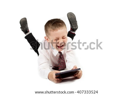Happy and funny School boy child with tablet pc on white background isolated - stock photo