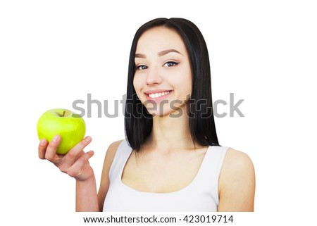 Happy and Healthy, natural organic raw fresh food concept / portrait of attractive smiling girl holding green apple in her hand over white background - stock photo
