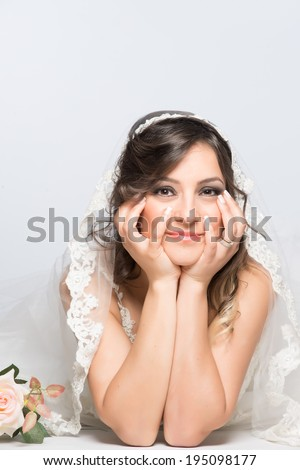 Happy and hopefull bride posing on the floor for engagement and marriage