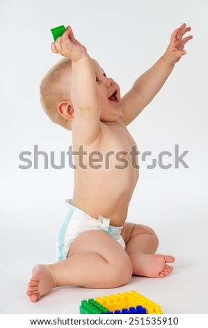 Happy and perky child plays with toys