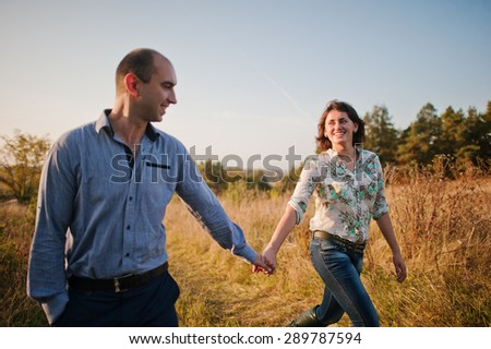 Happy and positive couple in autumn love story