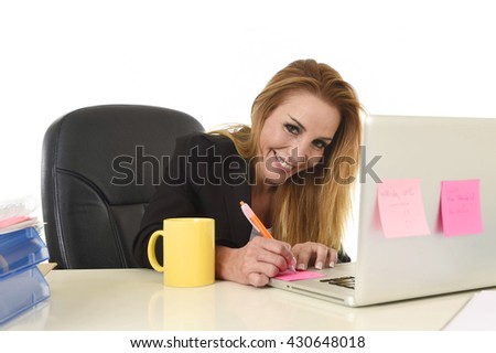 happy and relaxed 40s businesswoman with blond hair smiling confident taking notes in notepad working at laptop computer in female business success concept isolated white background - stock photo