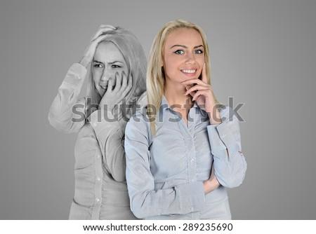 Happy and sad woman face - stock photo