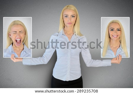 Happy and sad woman face - stock photo