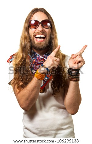 Happy and silly man dressed like a hippy pointing up at copyspace. Isolated on white. - stock photo