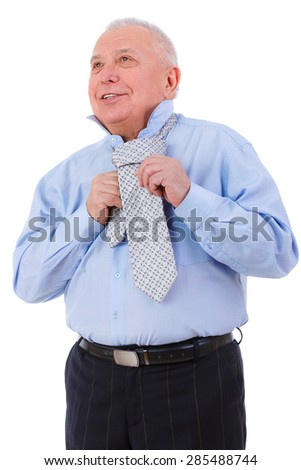 Happy and smile old mature businessman with white smile ties a tie. isolated on white background. Positive human emotion, facial expression  - stock photo