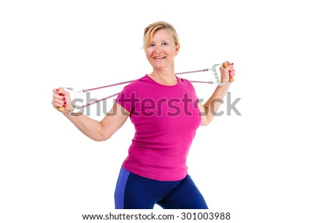 Happy and smile old senior blond woman dressed in shirt color Marsala doing fitness exercises with expander a resistance band, isolated on white background, Positive human emotions