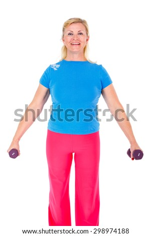Happy and smile old senior woman in sport outfit in gym working out with dumbbells in hands, isolated on white background, Positive human emotions - stock photo